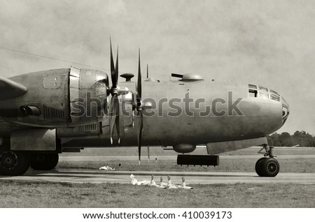 World War 2 era heavy bomber on the ground black and white - stock photo