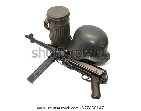 World War II Germany soldier equipment. Machinegun MP-38 near helmet and respirator case - stock photo