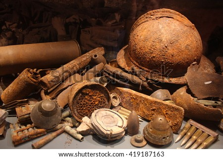 World war II remains, rusty helmet, bullets, mines and bombs.  - stock photo