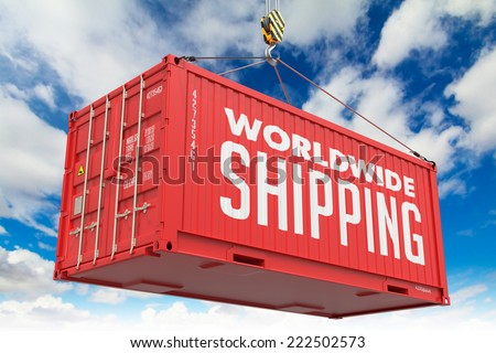 World Wide Shipping - Red Cargo Container hoisted with hook on Blue Sky Background. - stock photo