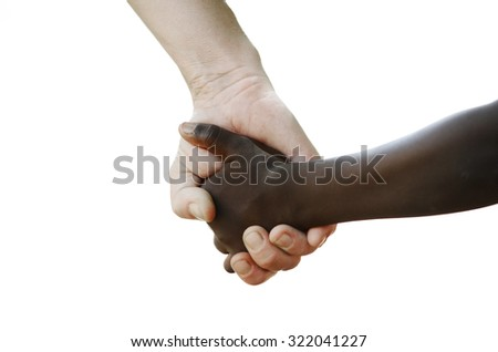 World Without Racism - Peace on Earth for Better Future. African Peace Symbol. White woman holds hands with a little native African girl, in Bamako, Mali. A black child and a white woman hold hands.  - stock photo