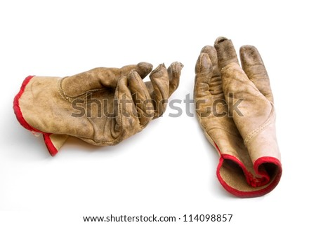 Worn and Weathered Gloves on White Backdrop - stock photo