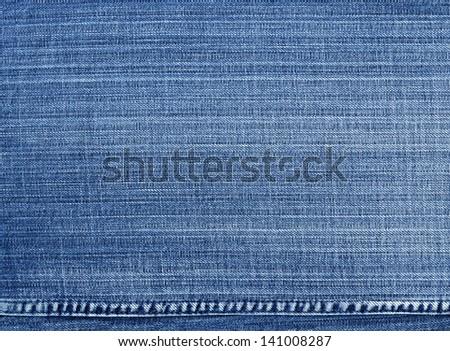 Worn blue denim jeans texture, background - stock photo