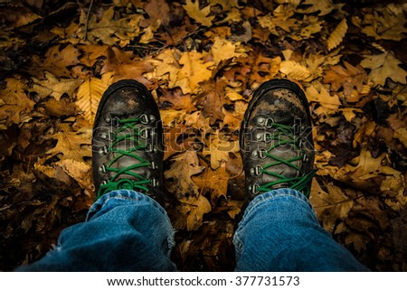 Worn Boots in the Woods - stock photo