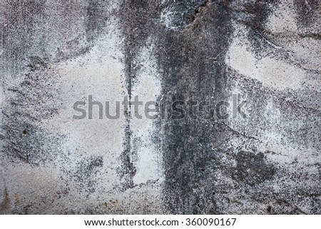 Worn grey cement stone wall - stock photo