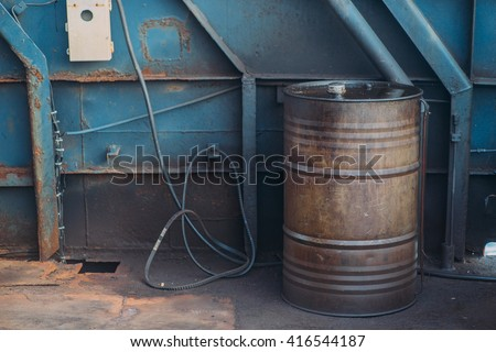 Worn metal barrel with fuel oil. Industrial background. .  - stock photo
