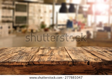 worn old table and kitchen  - stock photo