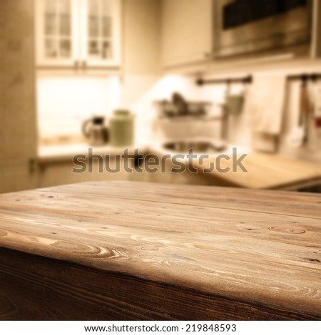 worn old table in rustic kitchen  - stock photo