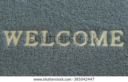 Worn-out, antique of welcome mat. - stock photo