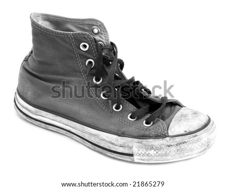 worn out old sneaker side on - stock photo