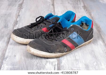 Worn sweaty sneakers - stock photo