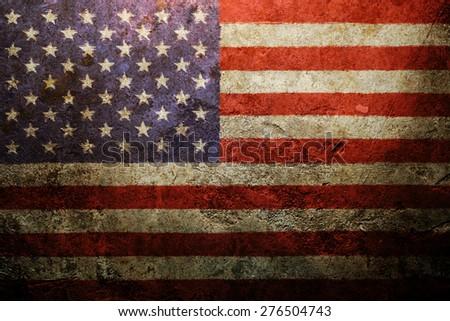 Worn vintage American flag background - stock photo