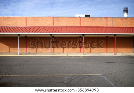 worn vintage old building and parking lot                            - stock photo