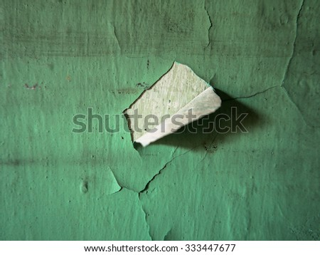 worn wall paint that is torn - stock photo