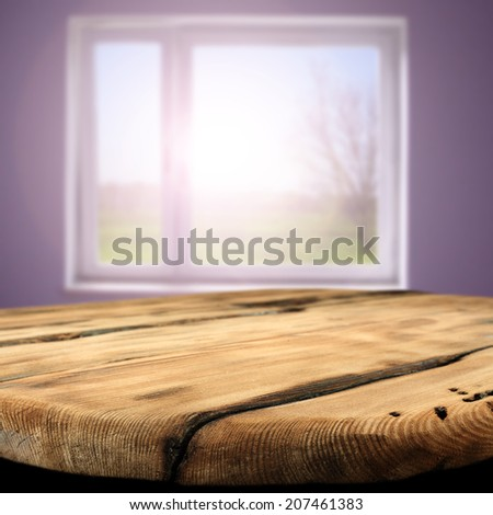worn wooden table and window  - stock photo