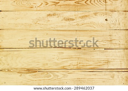 Worn wooden wall background or texture - stock photo