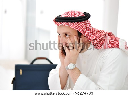Worried arabic businessman - stock photo