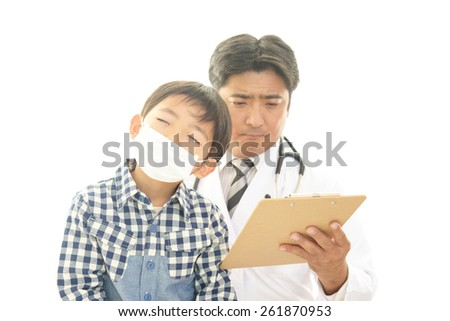 Worried Asian medical doctor - stock photo