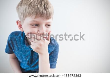 Worried boy staring  - stock photo
