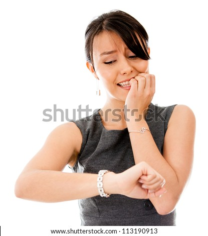 Worried business woman running late - isolated over a white background - stock photo