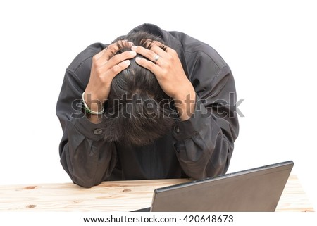 Worried businessman . a young man sits at his Desk and holds his hands on his head, on white background. - stock photo