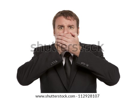 Worried Businessman covers his mouth - stock photo