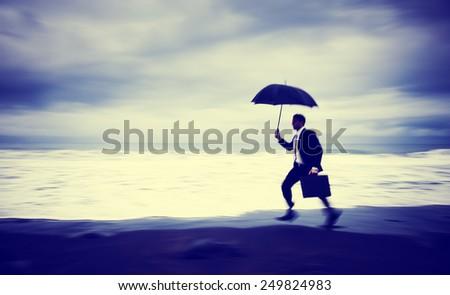 Worried Businessman Running Beach Concept - stock photo