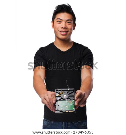 worried chinese man with a hard-drive - stock photo