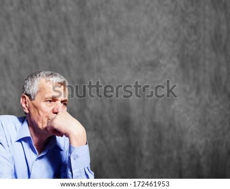 Worried elderly man - stock photo