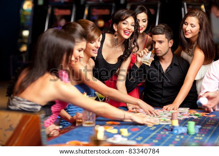 worried man with smiling females winning roulette - stock photo