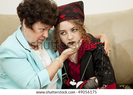 Worried mother trying to talk with her angry teenage daughter. - stock photo