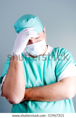 Worried or tired surgeon or an orderly - stock photo