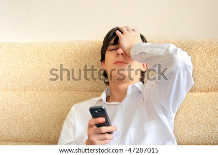 worried teenager with mobile phone - stock photo