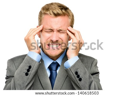 Worried young businessman suffering from headache - stock photo
