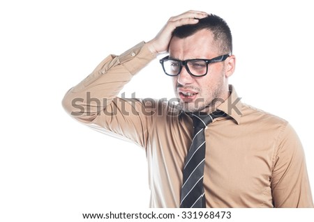 Worried young businessman with his hand on head. To late concept - stock photo