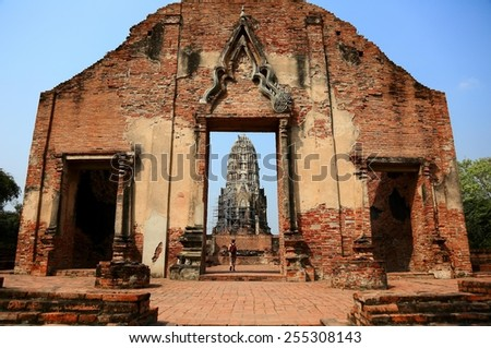 Worshipping in a ruined temple in  Ayutthaya,  Thailand ~ Wat Ratchaburana is one of the many ruined temple in Ayutthaya Historical Park~ - stock photo