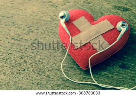 wound heart listen to music - stock photo