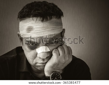 Wounded and cured man. Black and white portrait - stock photo