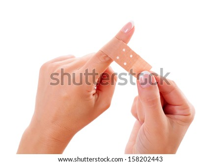 Wounded woman finger bandaged with plaster - stock photo