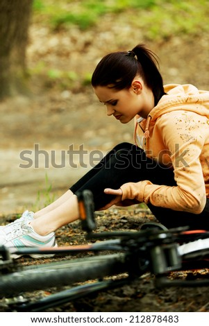 Wounded woman was falled off bicyle. - stock photo