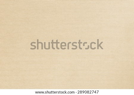 Woven cotton fabrics textile textured background in yellow gold cream beige color tone   - stock photo