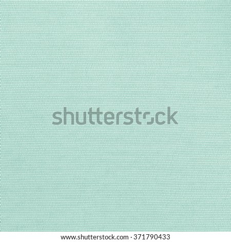 Woven cotton linen fabric textile textured backdrop in pastel light yellow green color tone: Flax satin cloth detail pattern wallpaper in cool cyan aqua toned colour: Eco friendly material - stock photo