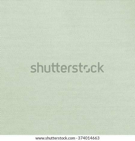 Woven cotton linen fabric textile textured backdrop in pastel light yellow spring green color tone: Flax satin cloth detail pattern wallpaper in cool lime toned colour: Eco friendly material - stock photo