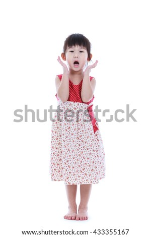 Wow. Full body of an adorable little asian girl in beautiful dress holding her mouth opened, hands on head and looking at camera. Studio shot. Isolated on white background. - stock photo