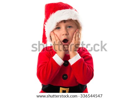 wow surprised  funny child girl in Santa red hat and costume . Christmas concept. - stock photo