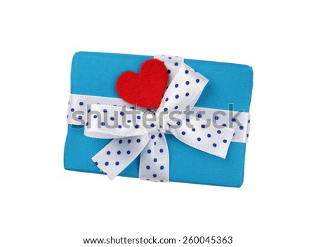 Wrapped blue gift box with ribbon bow and red heart - stock photo