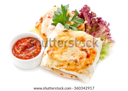 wrapped tortilla stuffed with beef chili and cilantro on a white background - stock photo