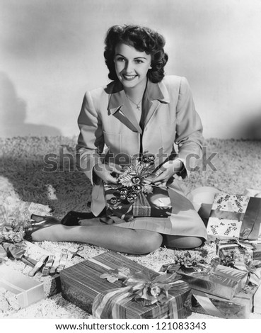 Wrapping Christmas presents - stock photo