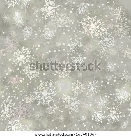 Wrapping Christmas vintage paper background with snowflake seamless pattern, subtle grunge texture, bokeh. Holiday winter retro wallpaper backdrop - stock photo