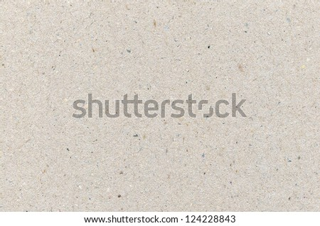 Wrapping paper cardboard texture, light rough textured copy space background, grey, gray, brown, tan, yellow, beige - stock photo